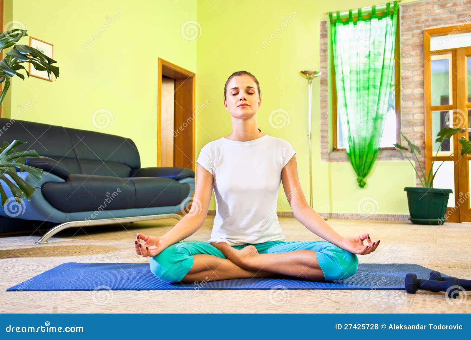 Young beautiful woman has meditation