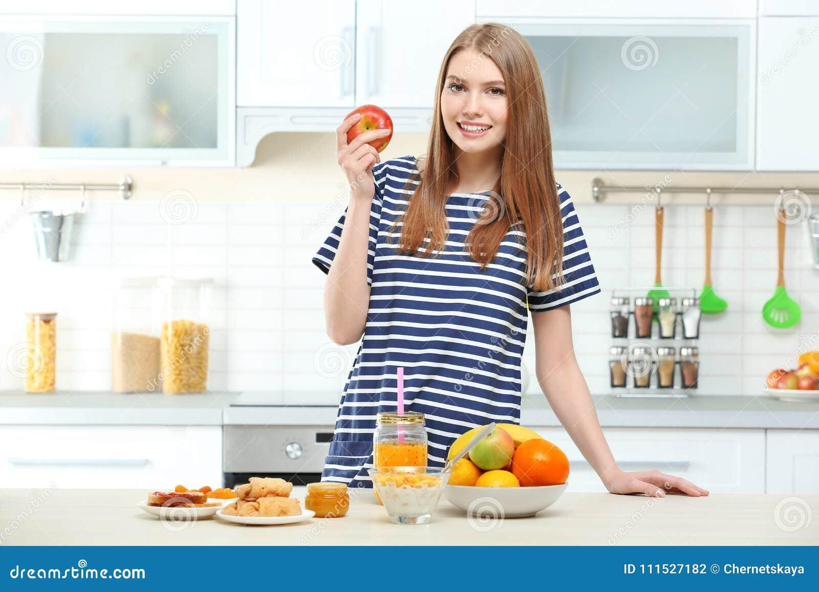 Young beautiful woman having breakfast