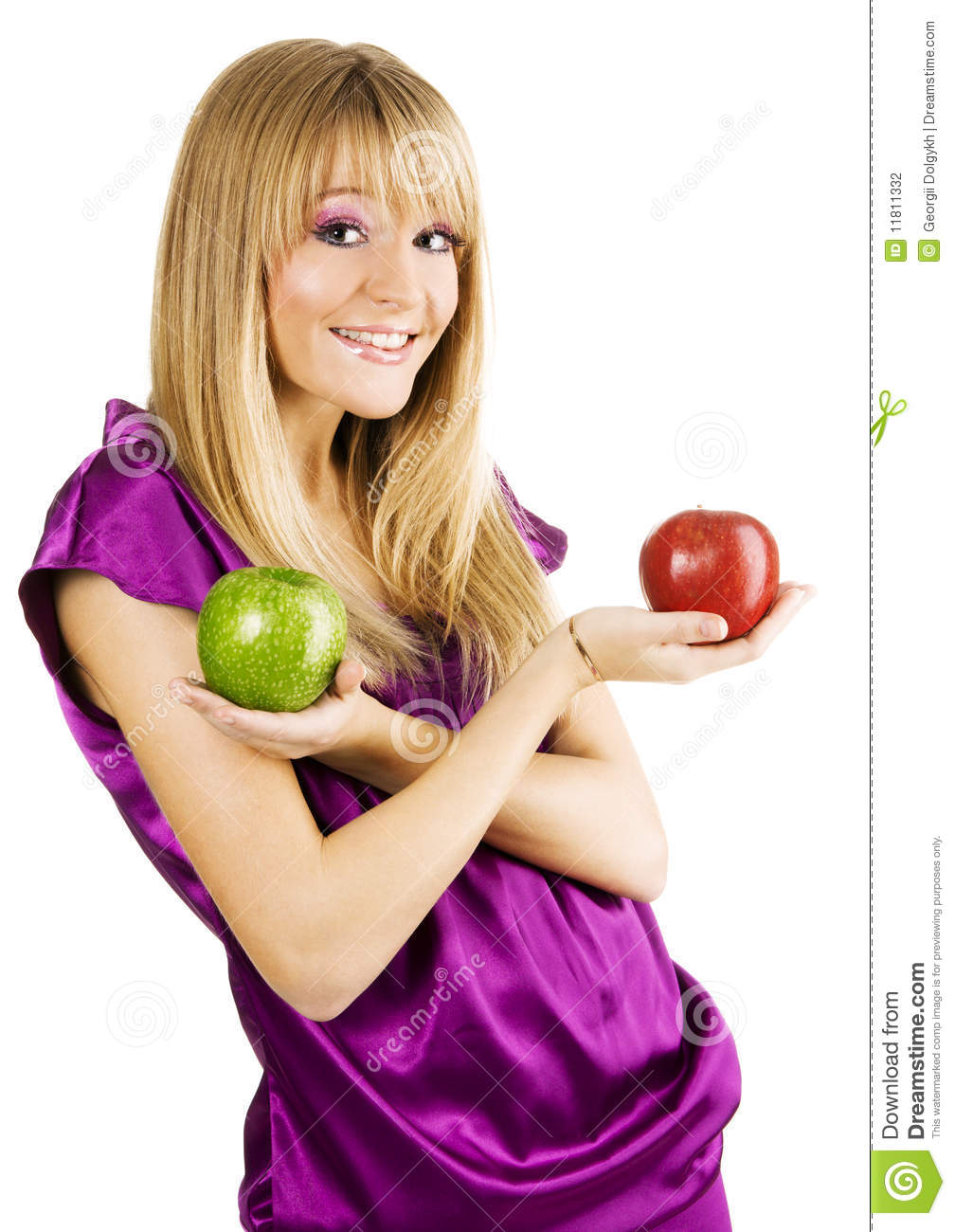 Young beautiful woman holding two apples