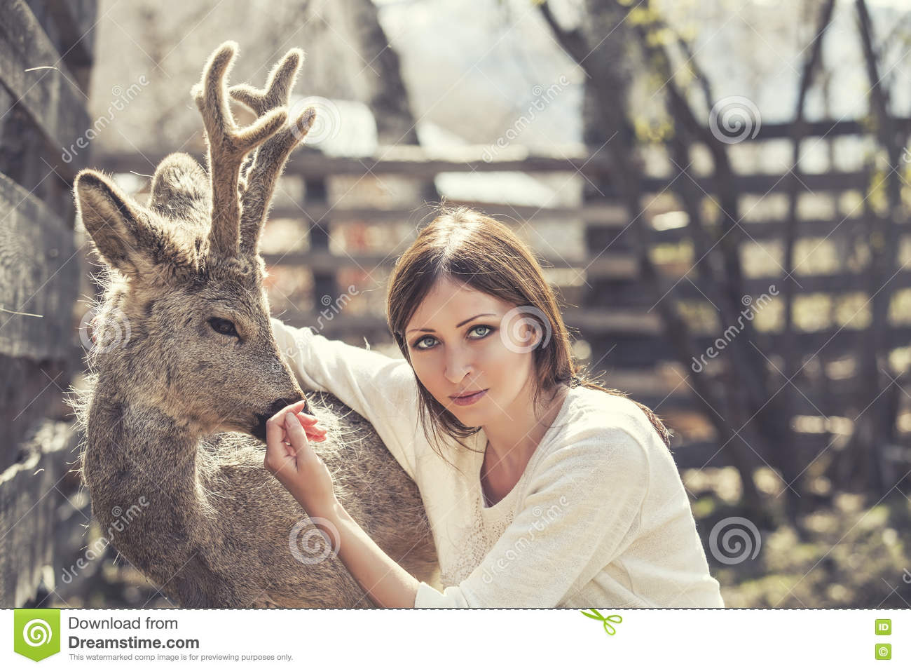 Young Beautiful Woman Hugging Animal Roe Deer In The
