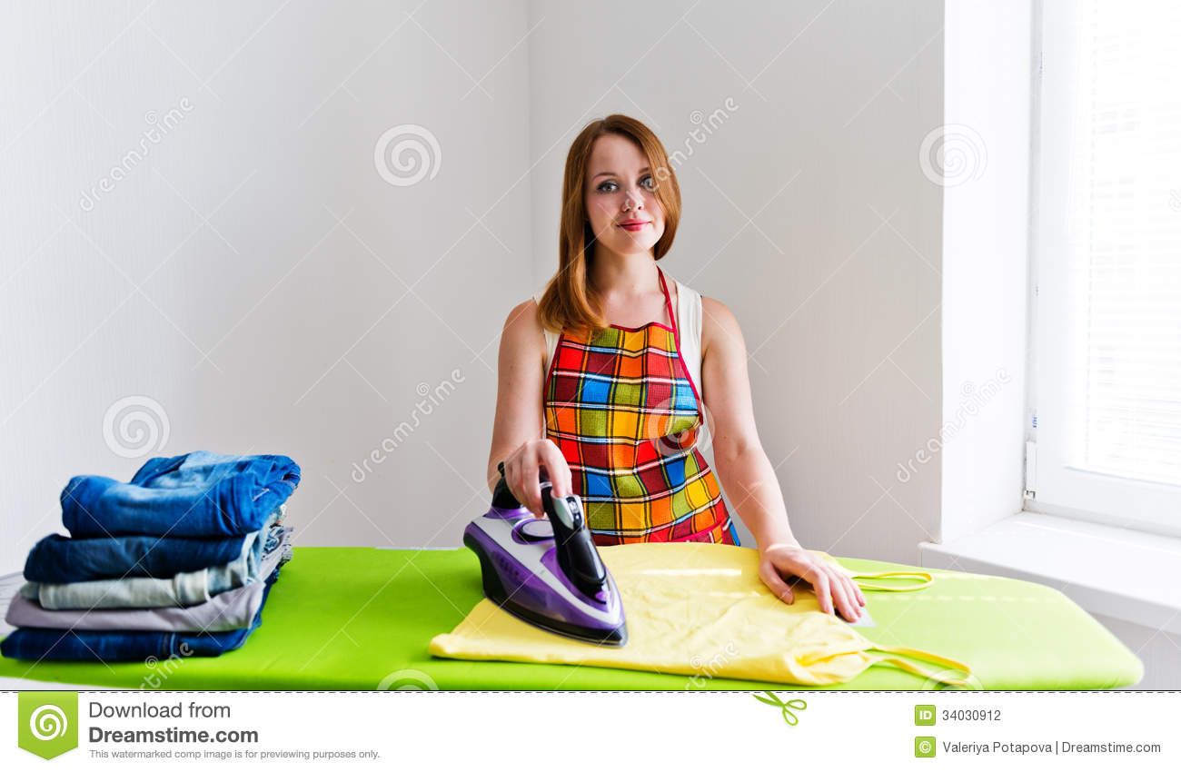 Young Beautiful Woman Ironing Clothes Stock Photo - Image ...