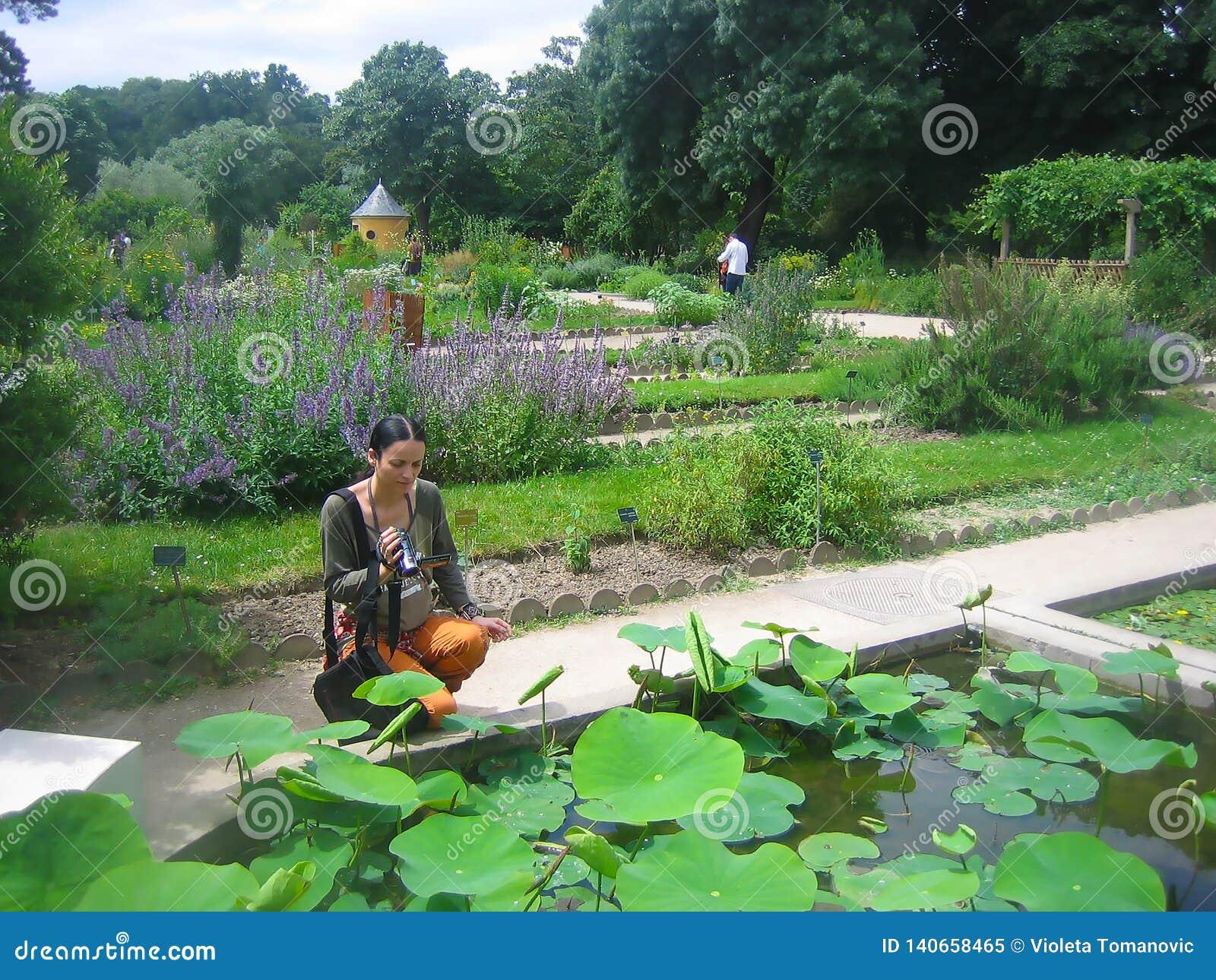 Young Beautiful Woman In Jardin Des Plantes, Paris Editorial Image ...