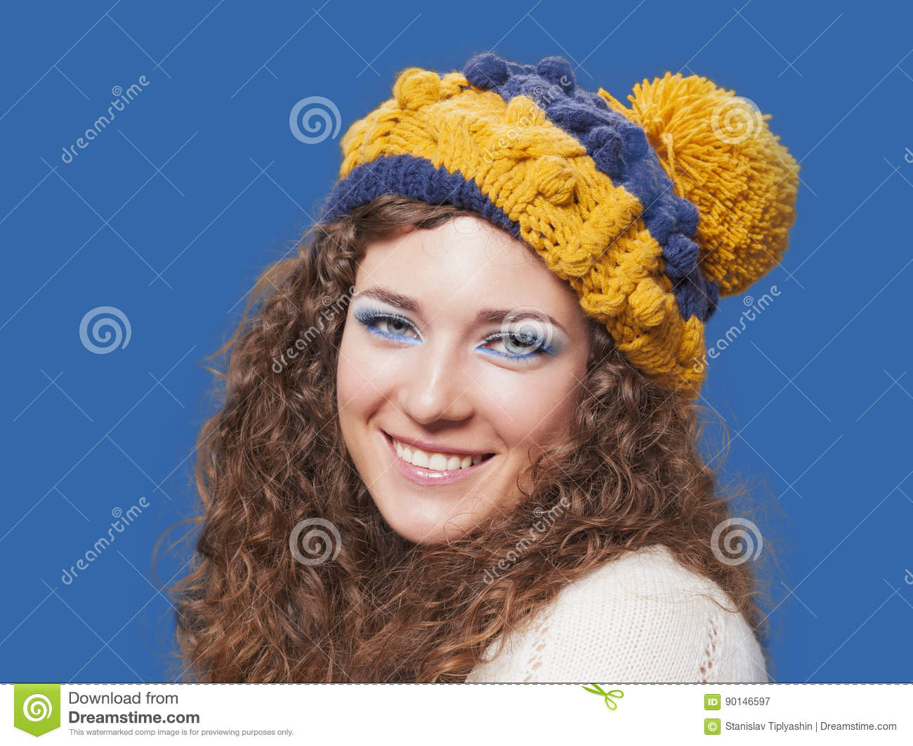 Young beautiful woman in knitted funny hat