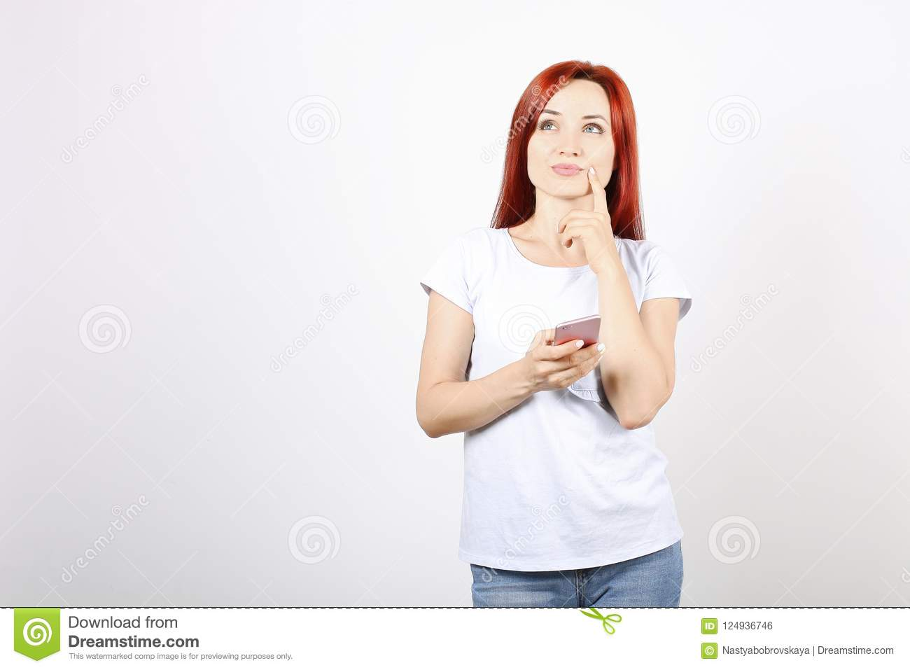 Close up portrait of successful young business woman posing and showing emotions on white background.