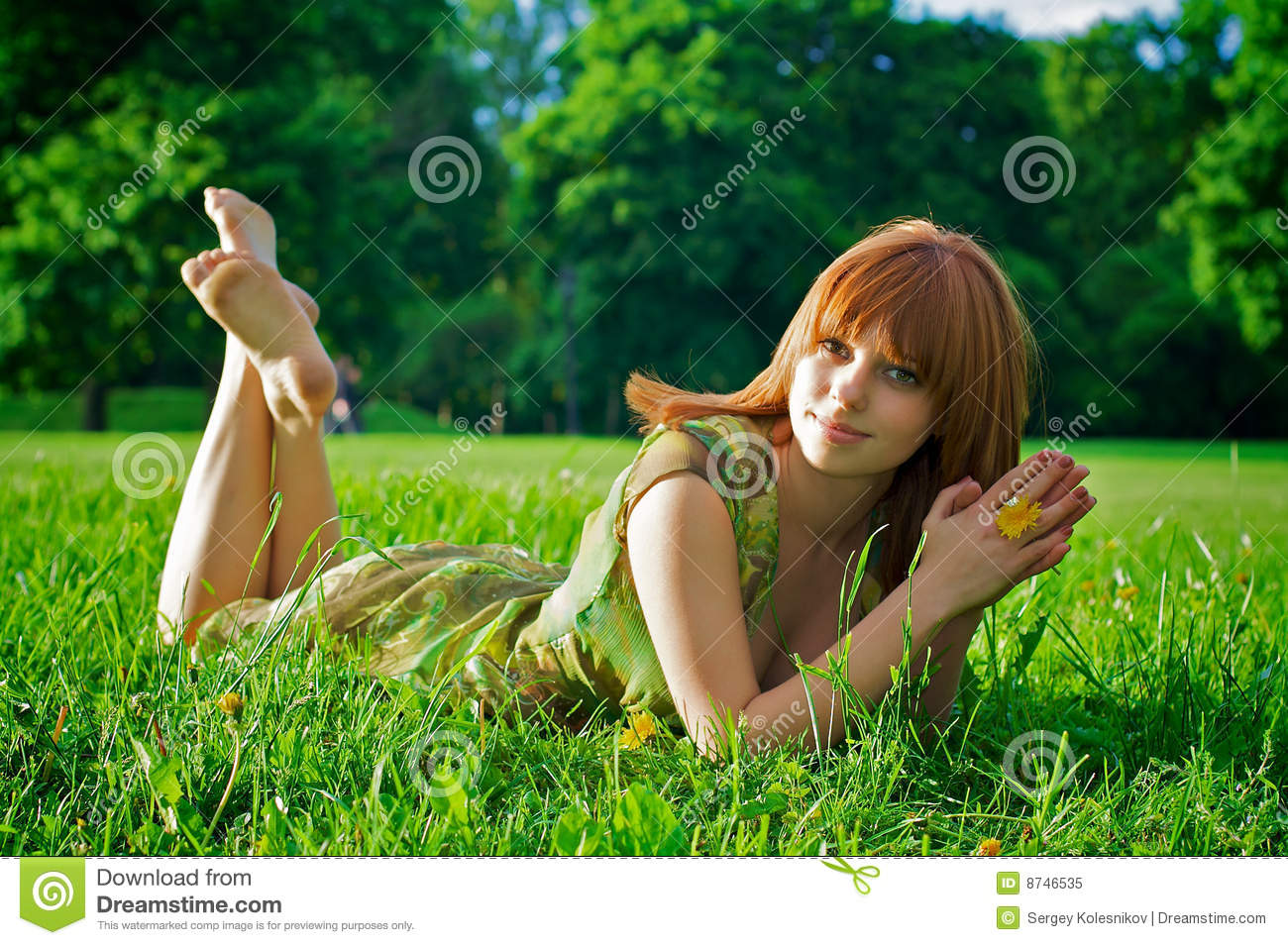 Young beautiful woman lying on grass royalty free stock for Pretty grass