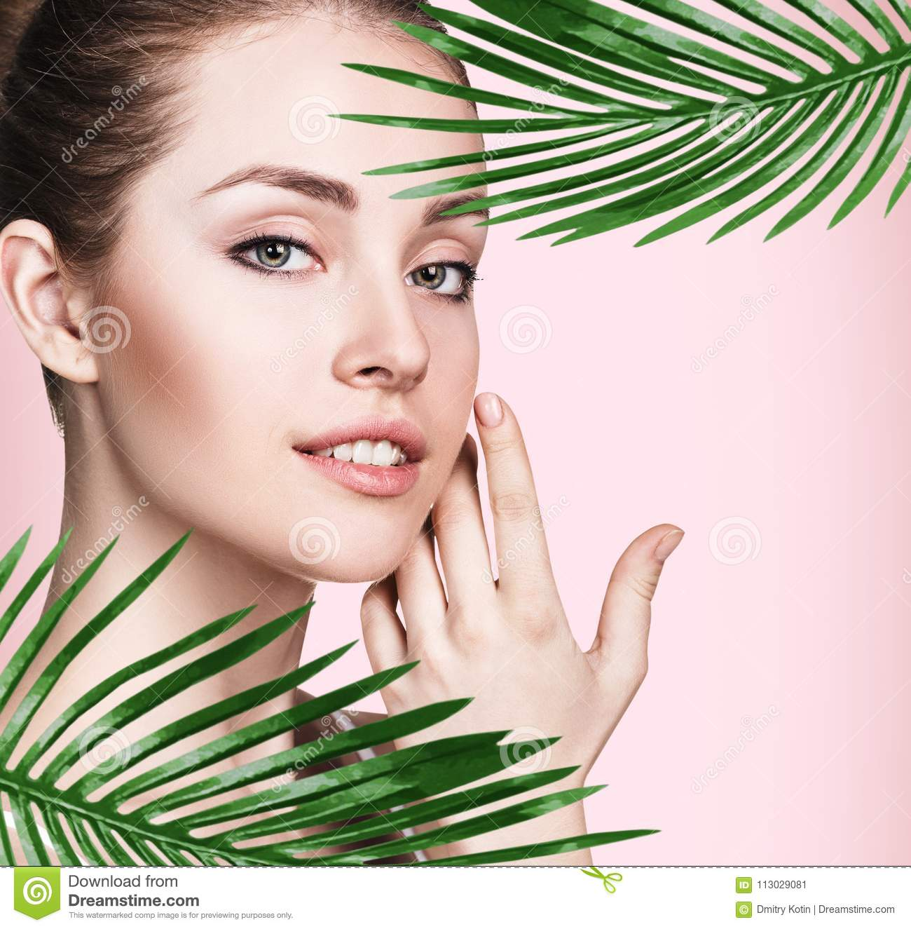 08cdd1b44acef Beautiful Woman With Perfect Skin Among Palm Leaves. Stock Image ...
