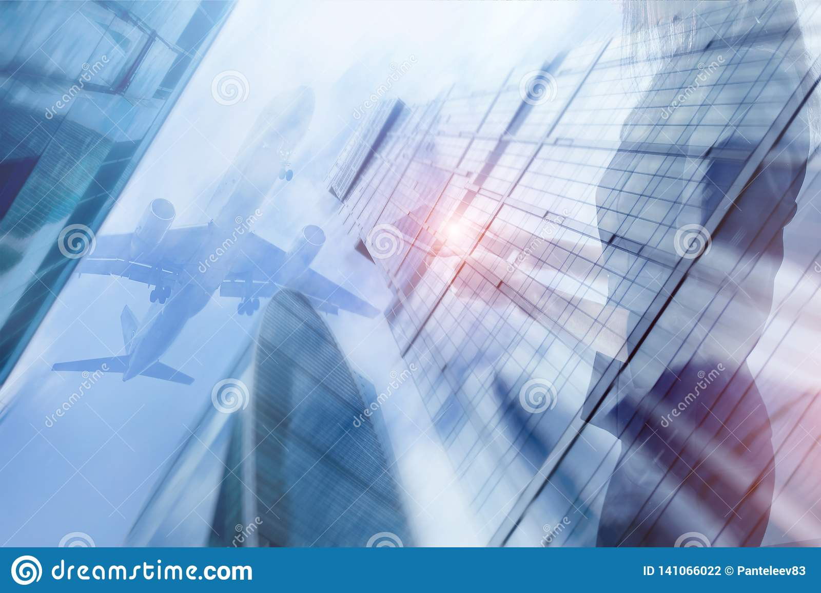 Young beautiful woman with portable touch pad in hands is enjoying view business center the airplane background. Mixed