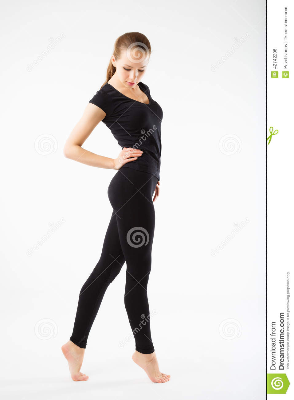 young beautiful woman posing in a gym outfit young