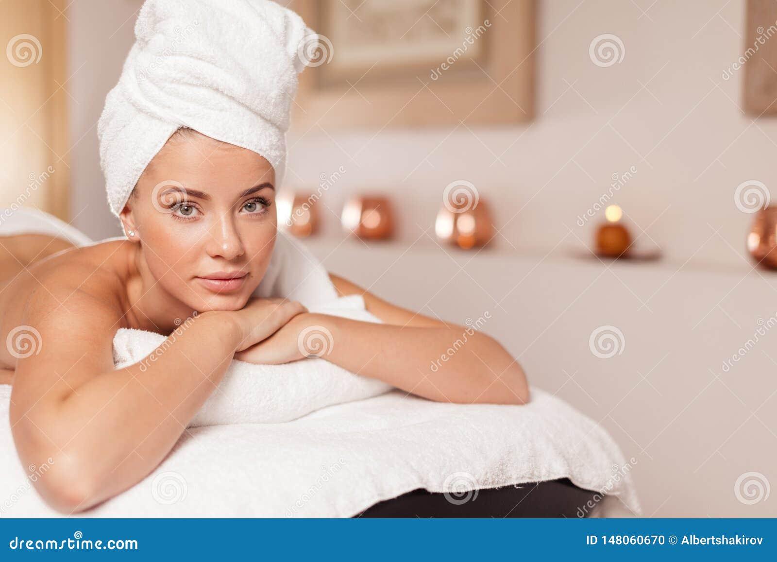 Young beautiful woman preparing for procedure
