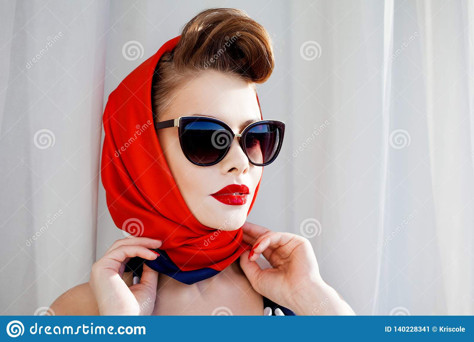 ae0181942bf49 Young Beautiful Woman With Red Lipstick And A Headscarf. Stock Image ...