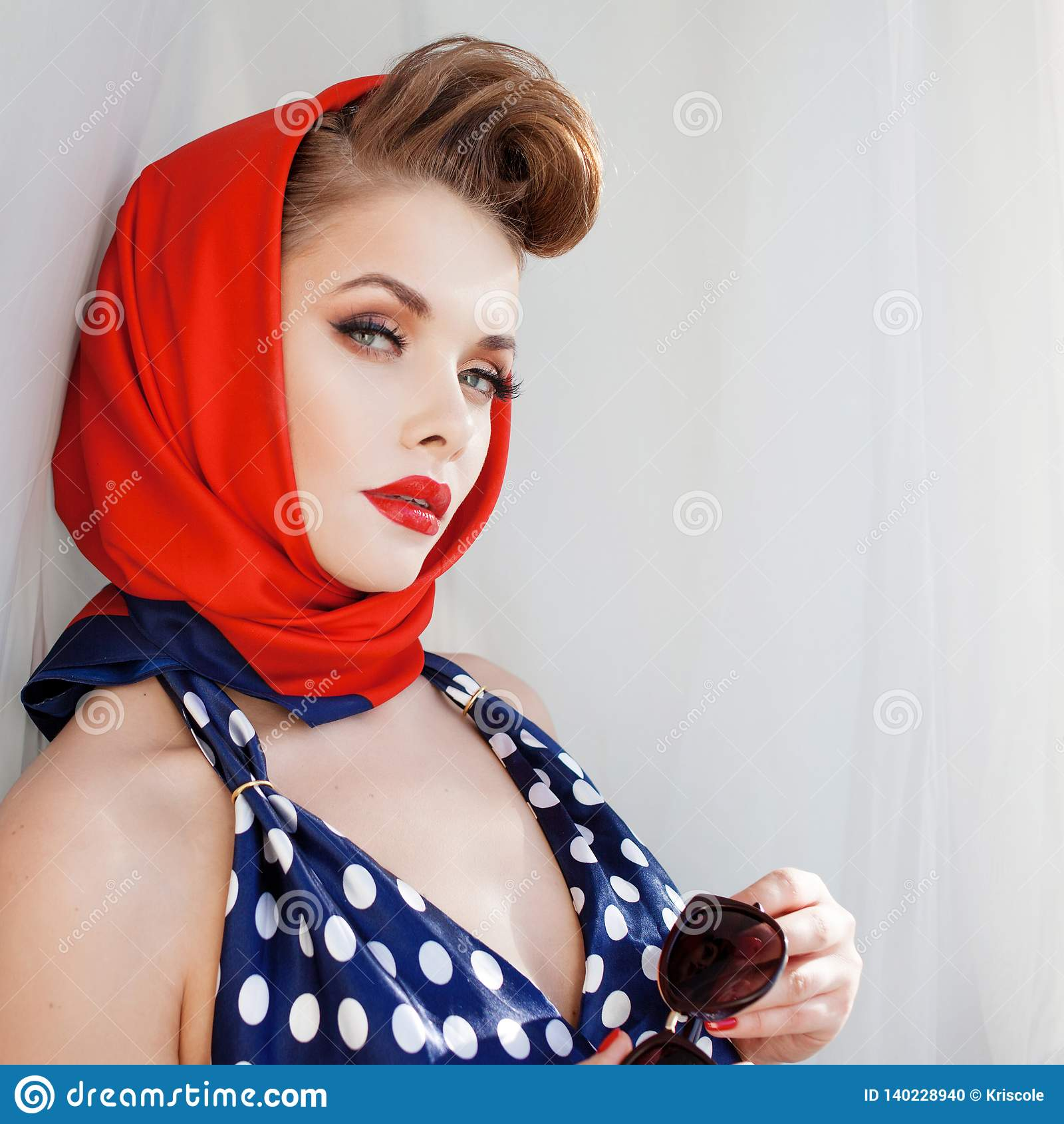 9a0d7f9d4a4aa Young Beautiful Woman With Red Lipstick And A Headscarf. Stock Photo ...