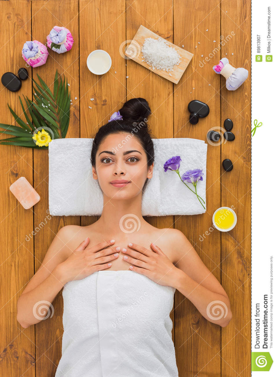 Young beautiful woman relax in aroma spa wellness center