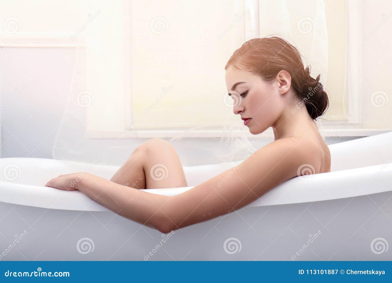 Young beautiful woman relaxing bath