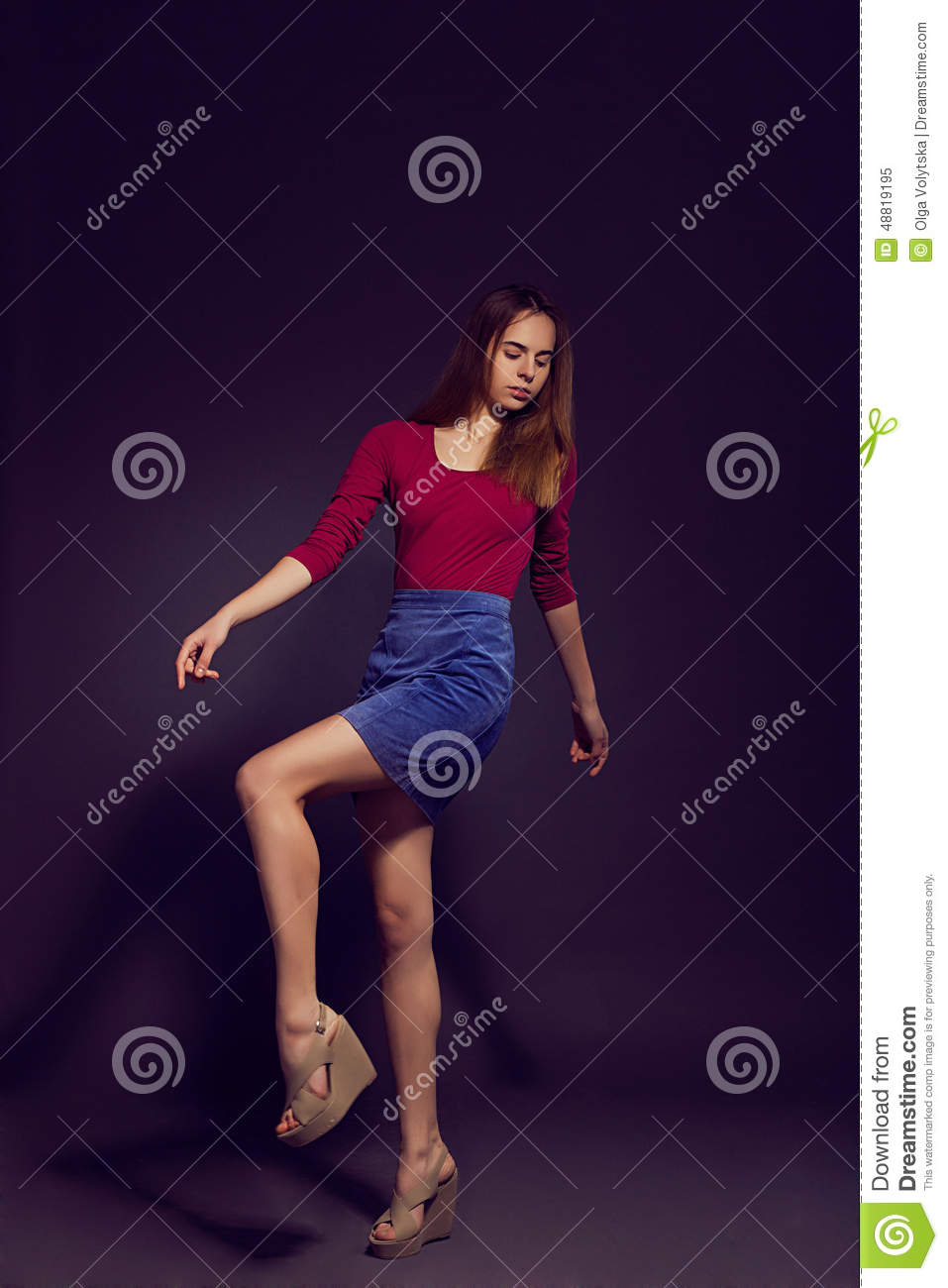 Young Beautiful Woman In Scarlet Kombidress, Suede Skirt