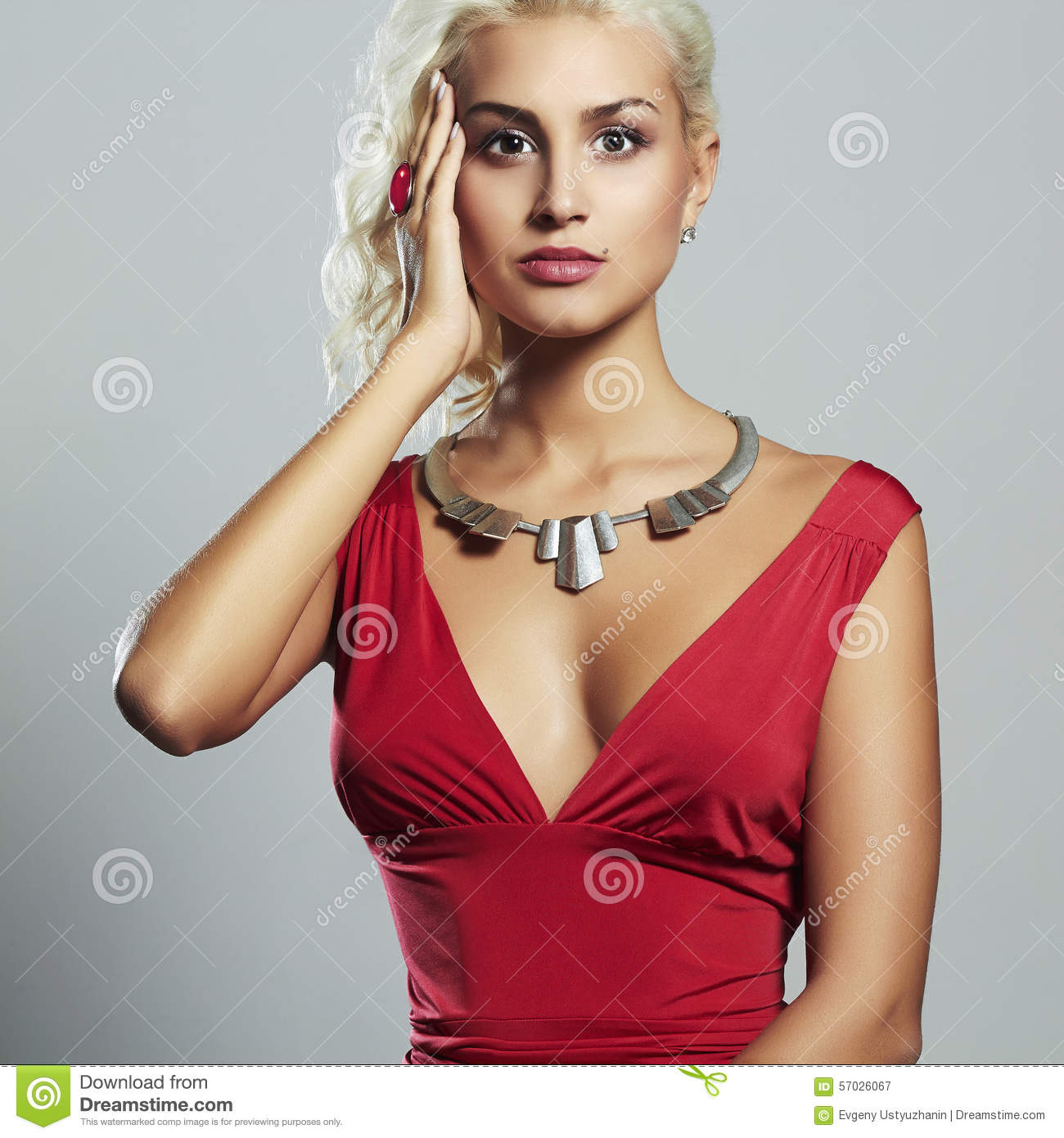 Young beautiful woman.Sexy body Blond girl.red dress