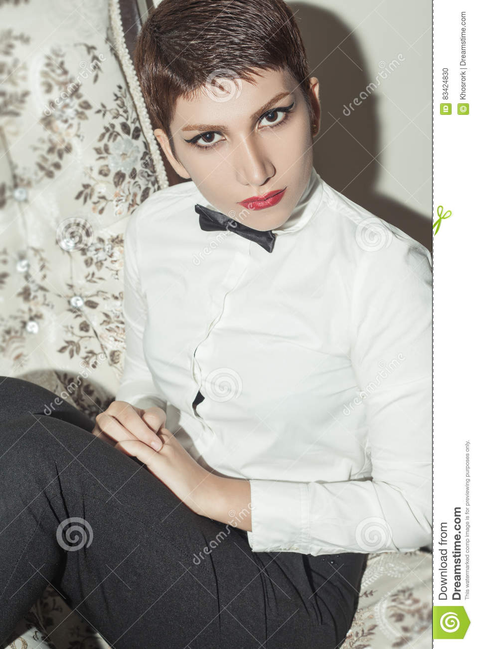 Young Beautiful Woman With Short Hair Style And Classic Wear With
