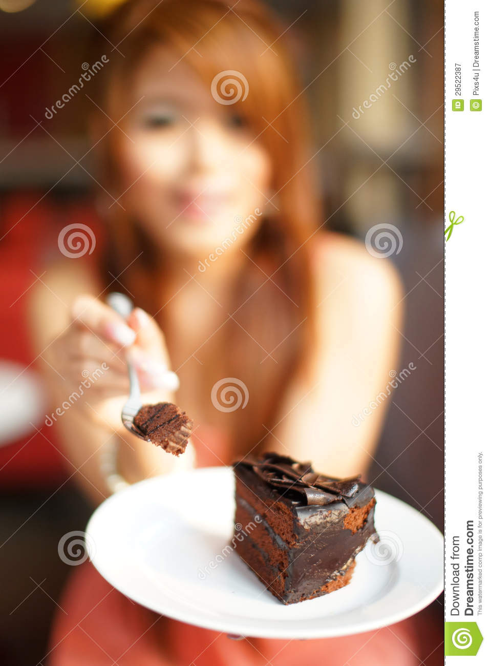 Young Beautiful Woman Sitting In Cafe Eating Chocolate ...