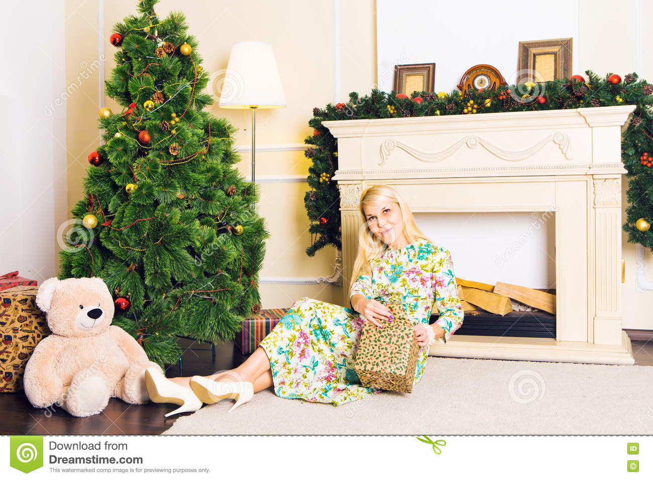 Young Beautiful Woman Sitting On Floor Near Christmas Tree ...