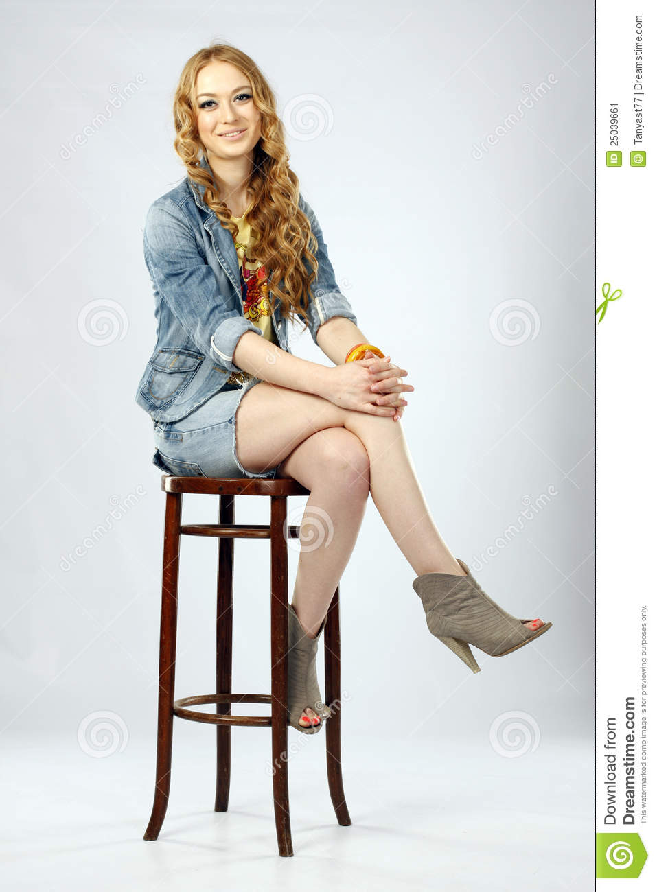 Young Beautiful Woman Sitting On A Stool Stock Image  : young beautiful woman sitting stool 25039661 from www.dreamstime.com size 957 x 1300 jpeg 98kB