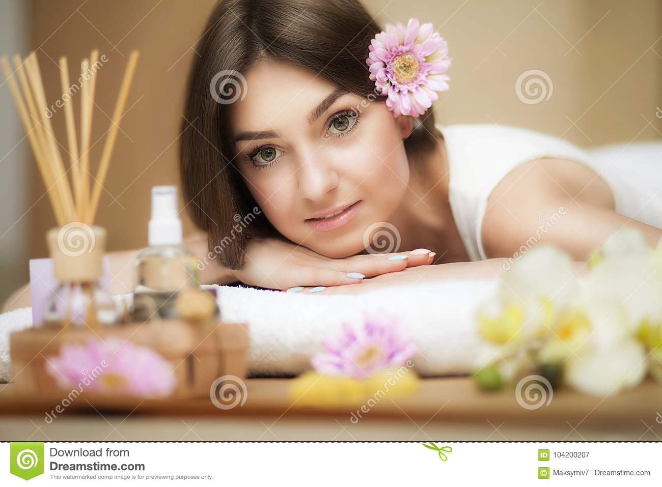 Young beautiful woman on the spa. Aroma oil and butter. Nice look. The concept of health and beauty. Better In the spa salon.