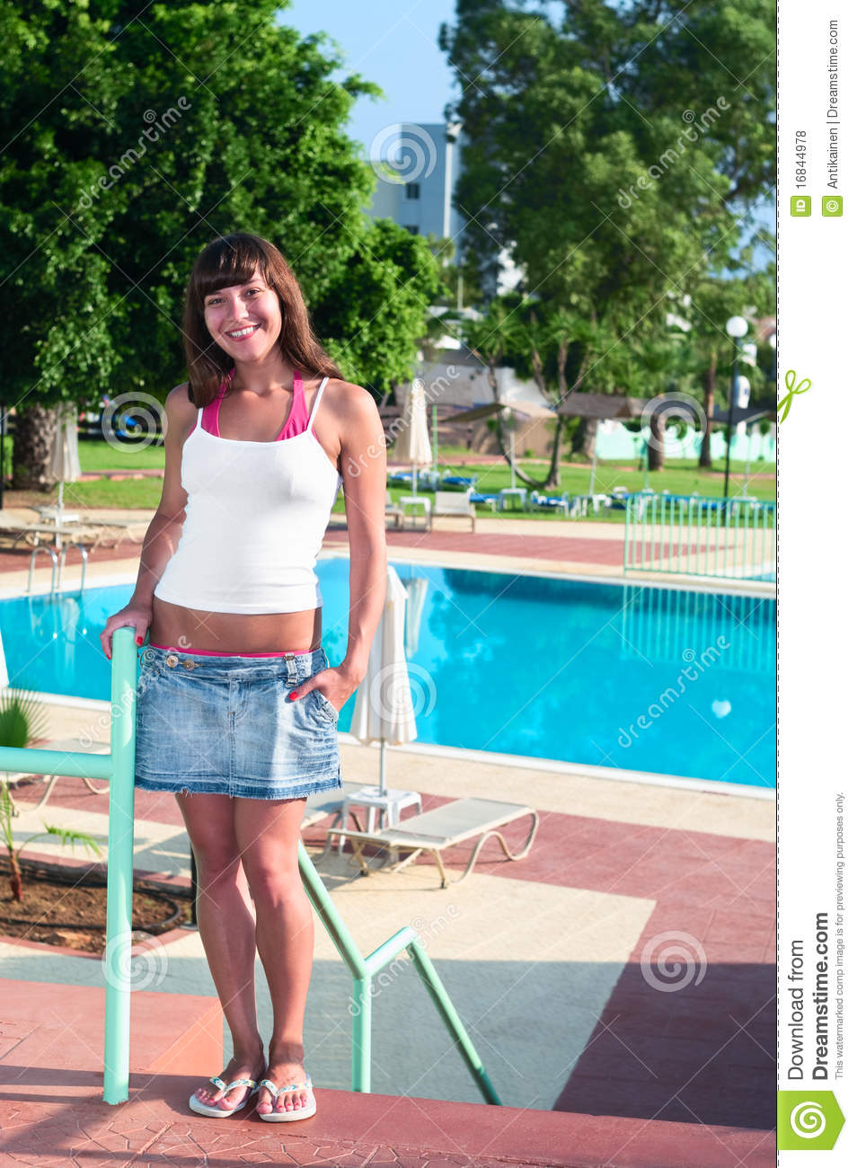 Young beautiful woman standing near swimming pool stock - Where is my nearest swimming pool ...