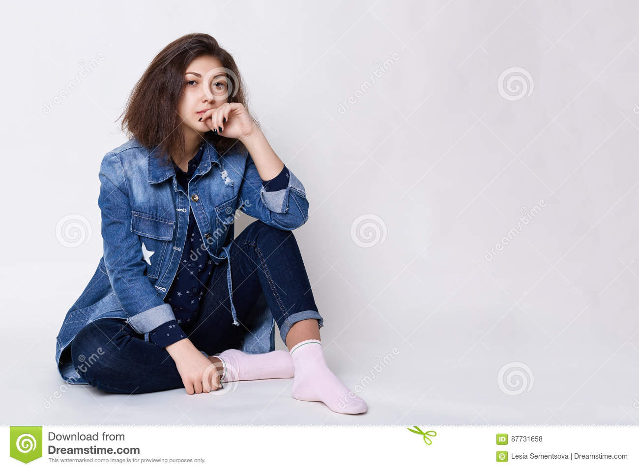 Young Beautiful Woman With Stylish Hairstyle Wearing Jean Clothes