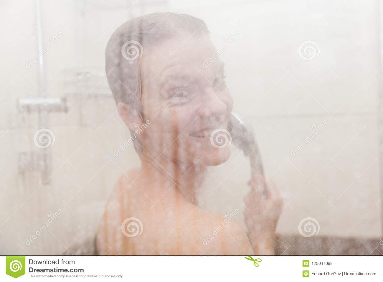 The Young Woman Uses A Shower In The Bathroom Of Her House Stock