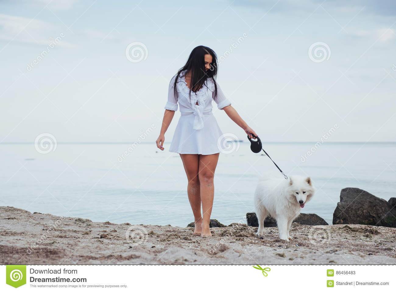 Woman walking on a beach royalty - Royalty Free Stock Photo