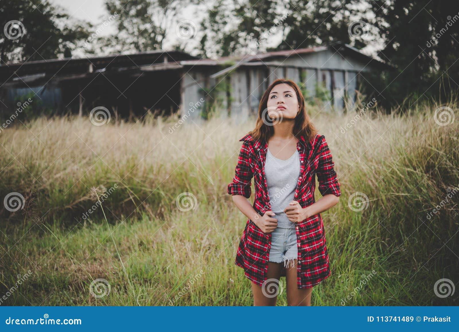Young beautiful woman walking through in summer field, Freedom e