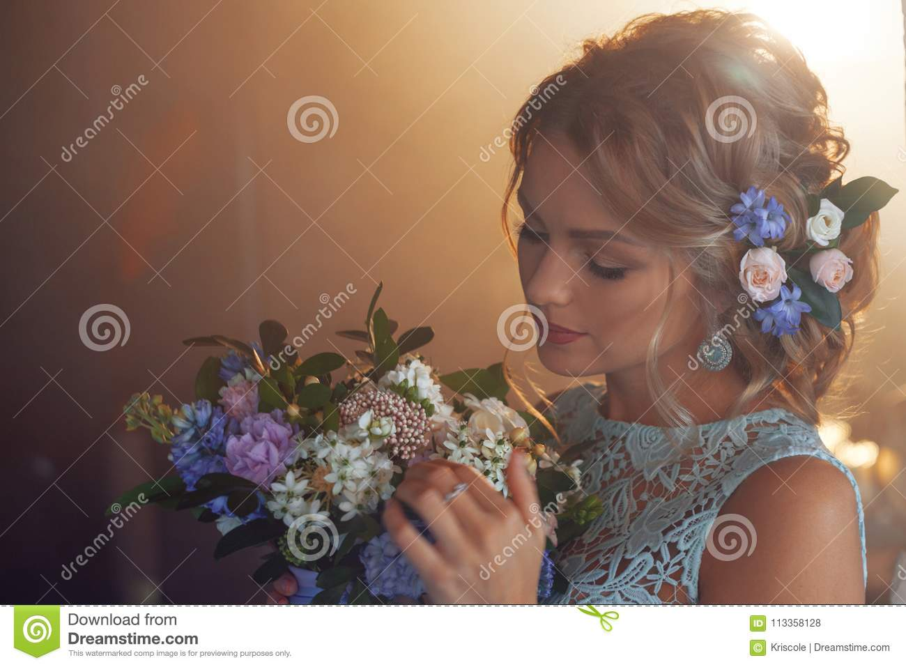 Young beautiful woman in wedding dress with bouquet of flowers young beautiful woman in wedding dress with bouquet of flowers wedding hairstyle flowers in hair bride in loft interior izmirmasajfo