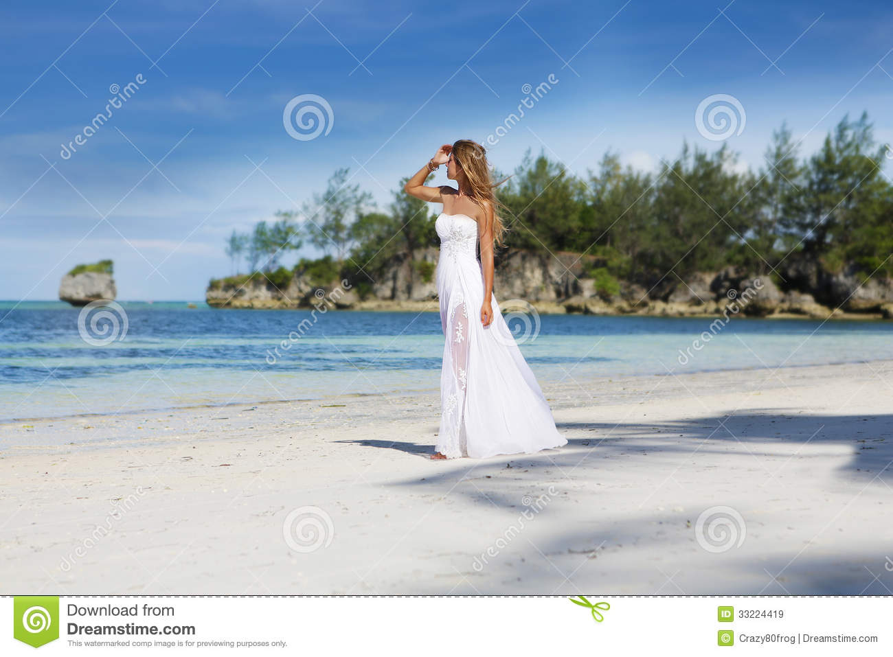 Young beautiful woman in wedding dress on tropical beach for Tropical beach wedding dress