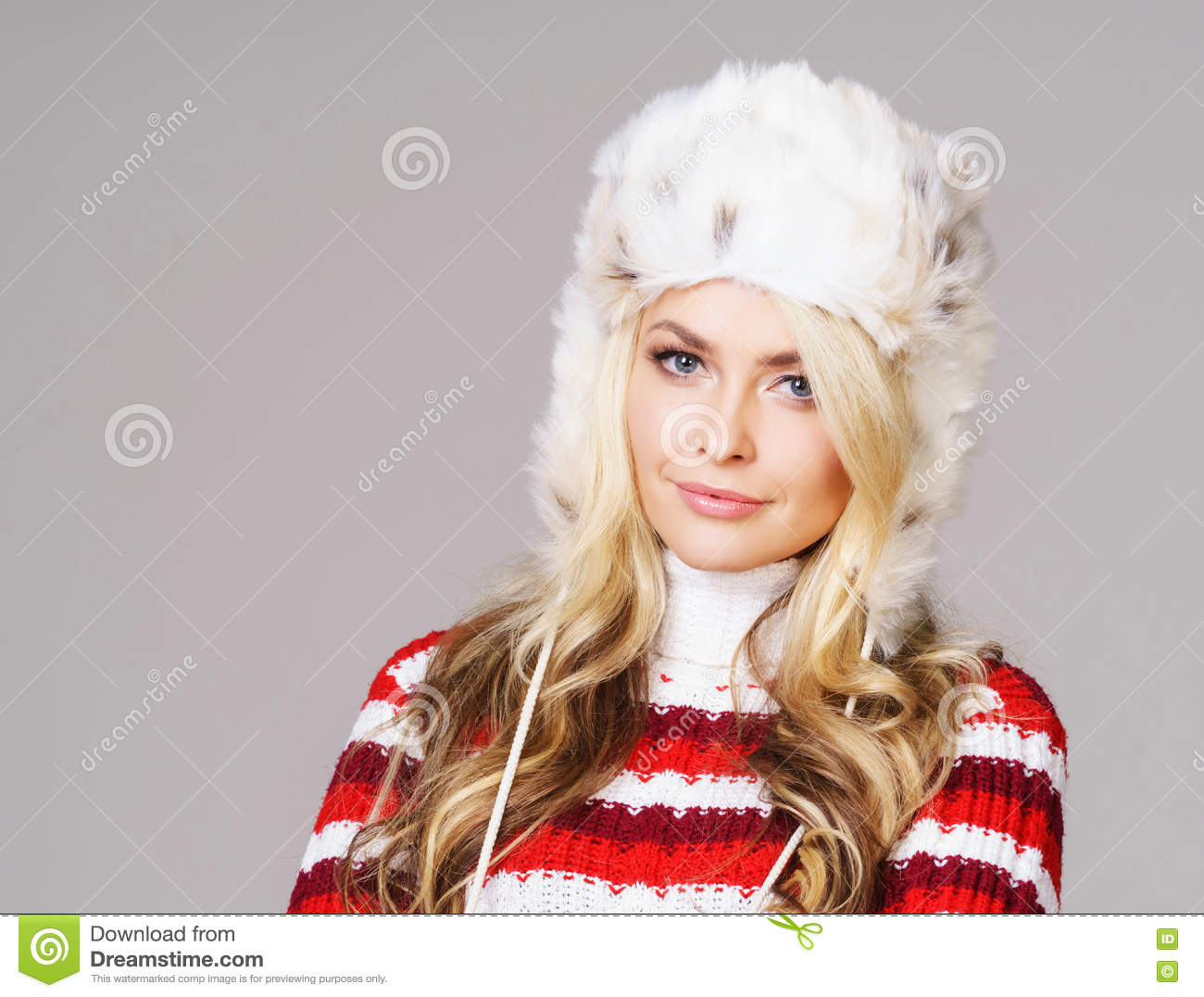a8ae57d7e5ff Portrait of young and beautiful woman in winter wear. Grey background.  Christmas, xmas, x-mas concept.
