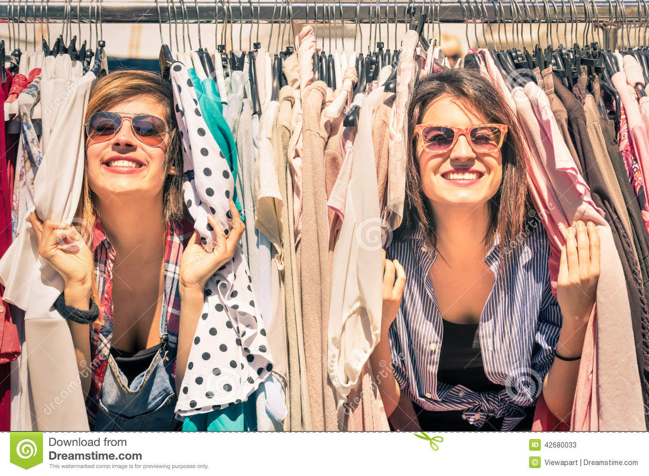 Young beautiful women girlfriends at the weekly cloth market