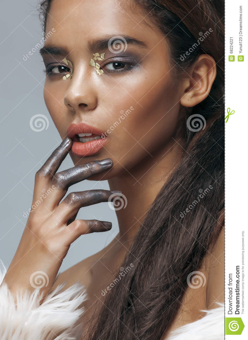 Young beauty african american mulatto woman with fashion make up, emotional face closeup
