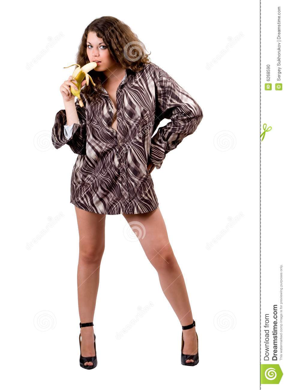 Young beauty woman in a man s shirt