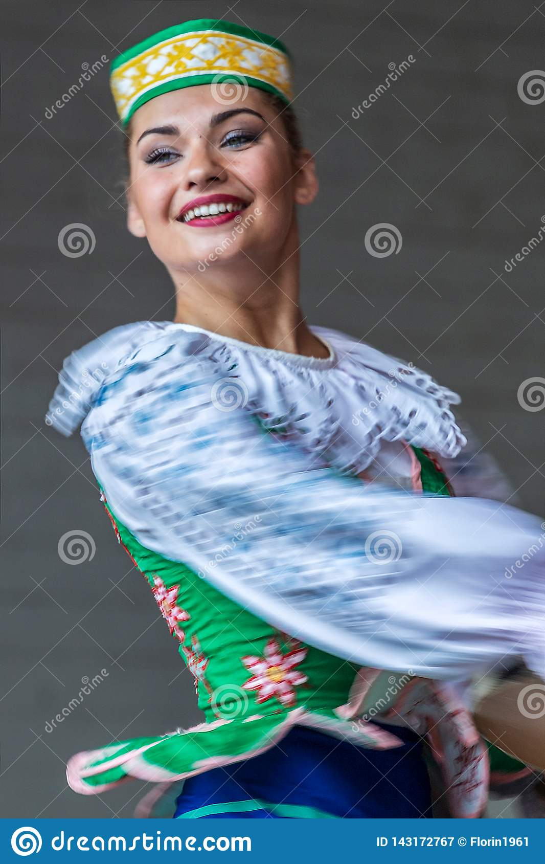 Young Belorussian dancer in traditional costume