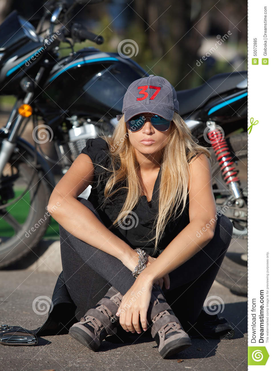 Young Biker Girl Sitting In Front Of A Motorcycle Stock Image - Image Of Metal, Black -8773