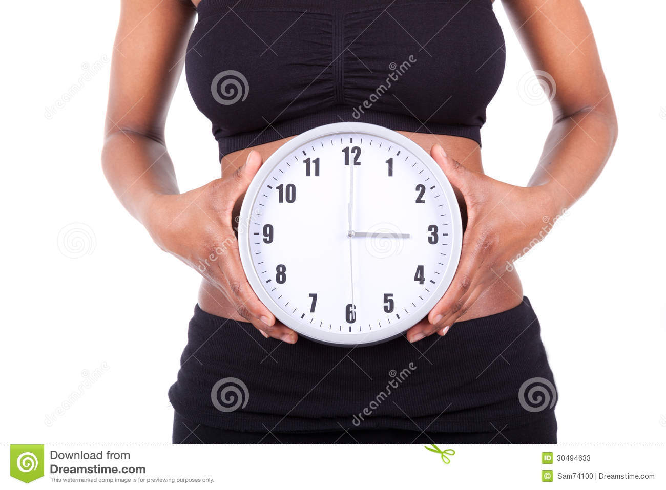 young black african american woman holding a clock in