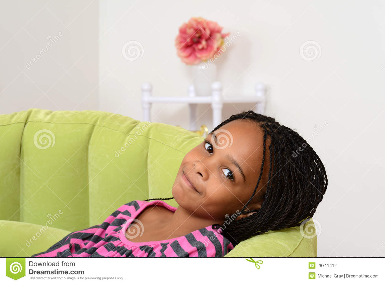 Black Child Sitting In Chair - Young black child relaxing in green chair