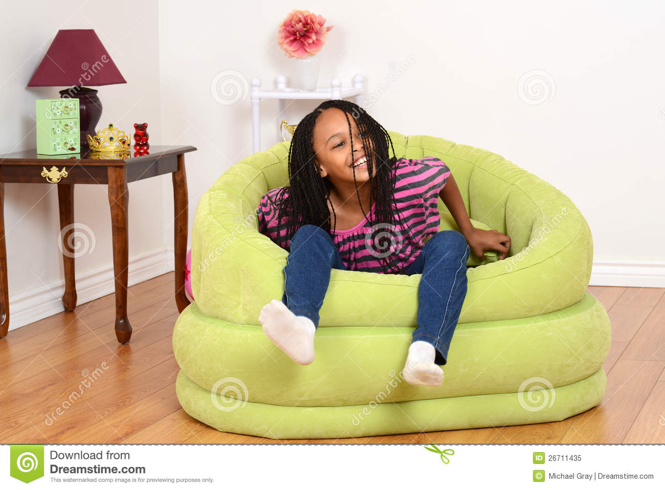 Black child sitting in chair - Young Black Child Trying To Get Out Of Chair Royalty Free Stock Photo