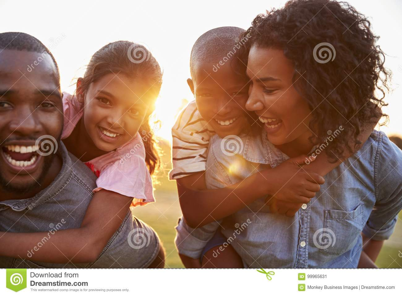 Young black couple enjoying family time with children