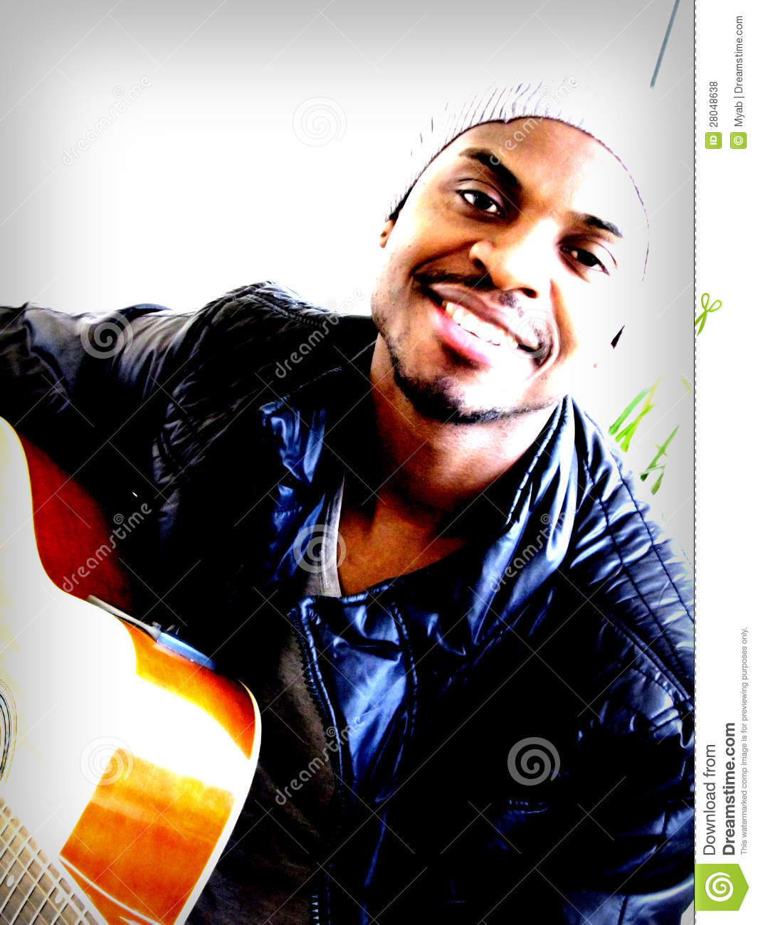 Young black man playing guitar
