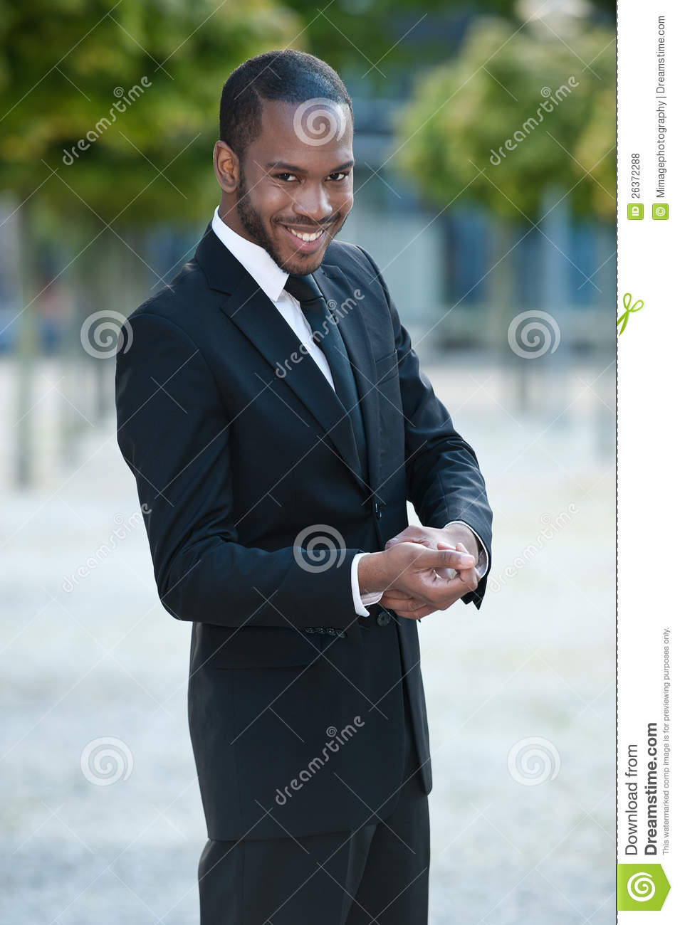 Young Black Teenage Men Playing Video Games: Young Black Man Smiling In A Suit Outside Stock Photo