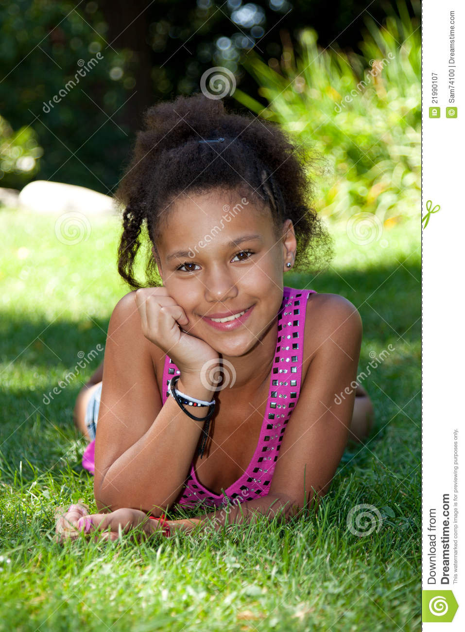 Young Black Teenage Men Playing Video Games: Young Black Teenage Girl Lying On The Grass Royalty Free
