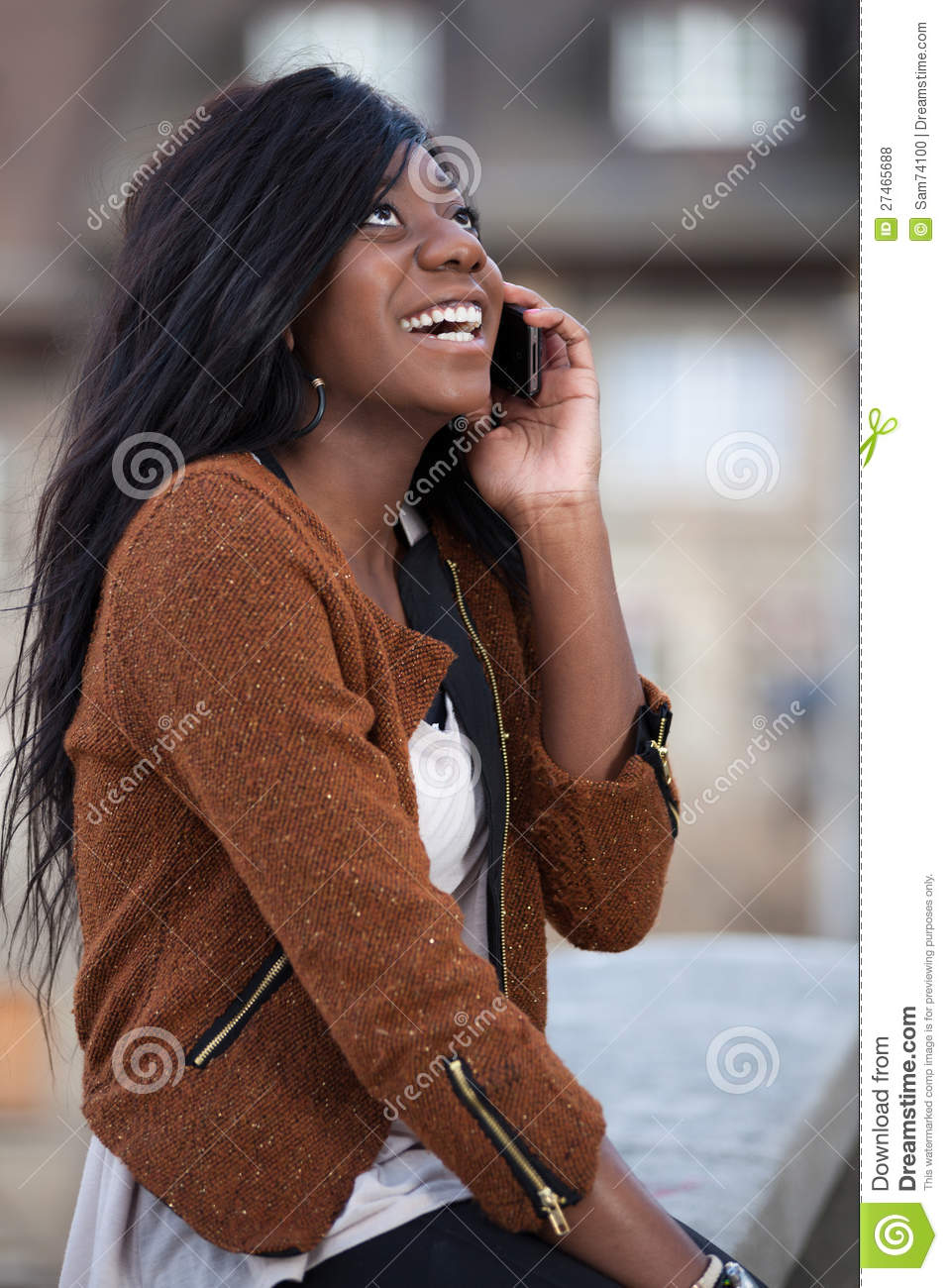 Young Black Teenage Girl Using A Mobile Pho Royalty Free