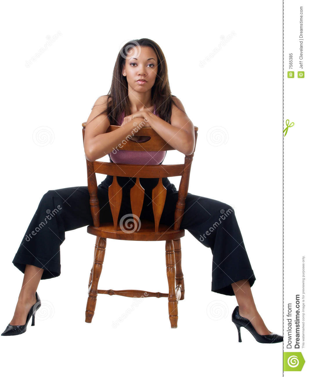 Young black woman staddling chair in pants outfit  sc 1 st  Dreamstime.com & Young Black Woman Staddling Chair In Pants Outfit Stock Image ...