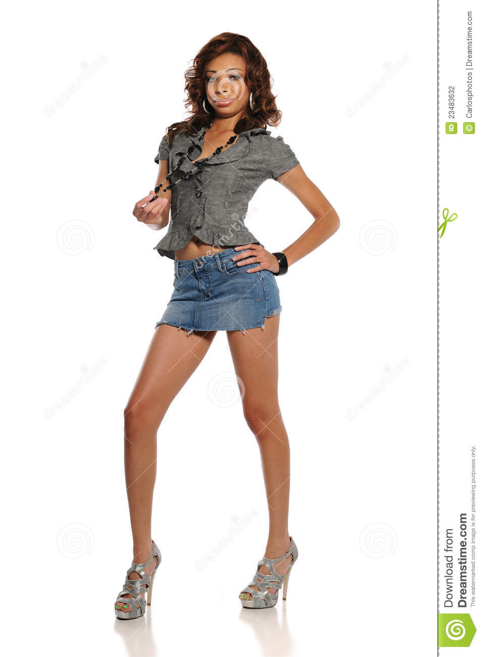 Young black woman wearing a mini skirt isolated on a white background