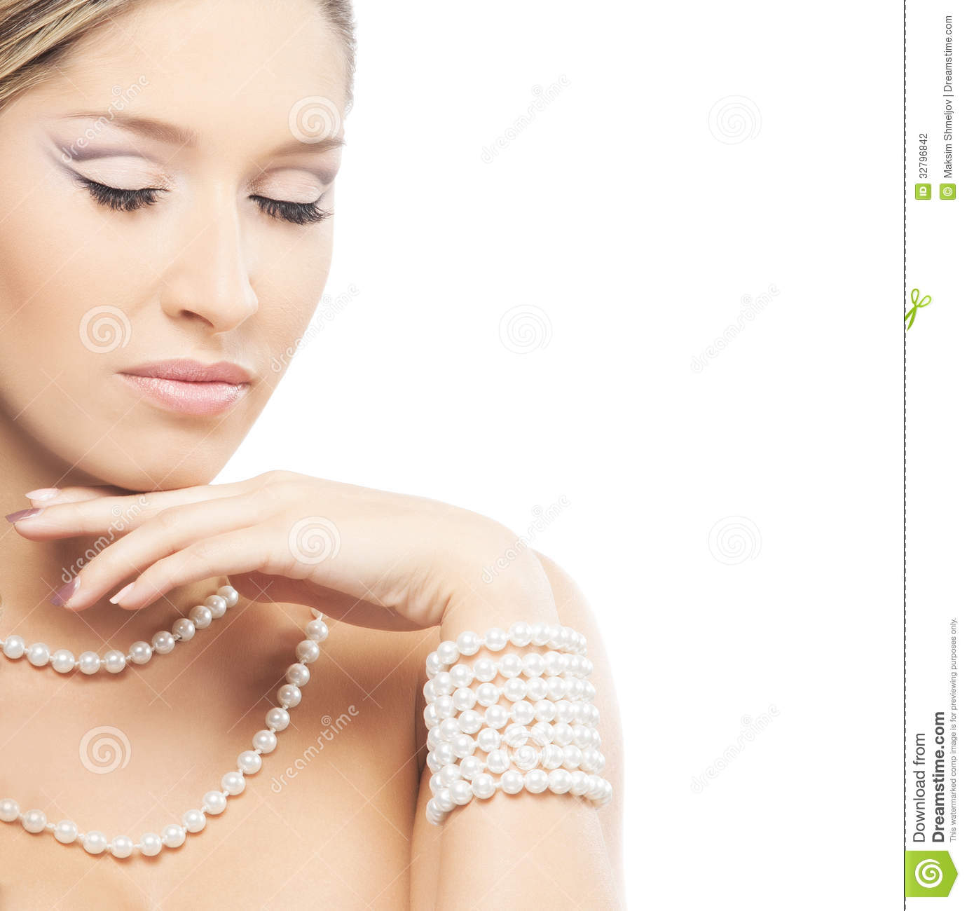 A Young Blond Bride Posing In Beautiful Makeup Stock Photo