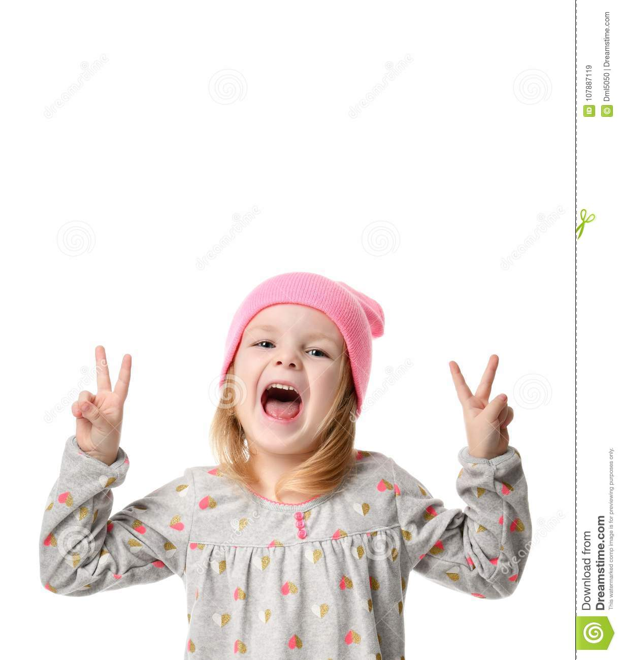 Young blond girl in birthday party princess hat hands show peace sign screaming