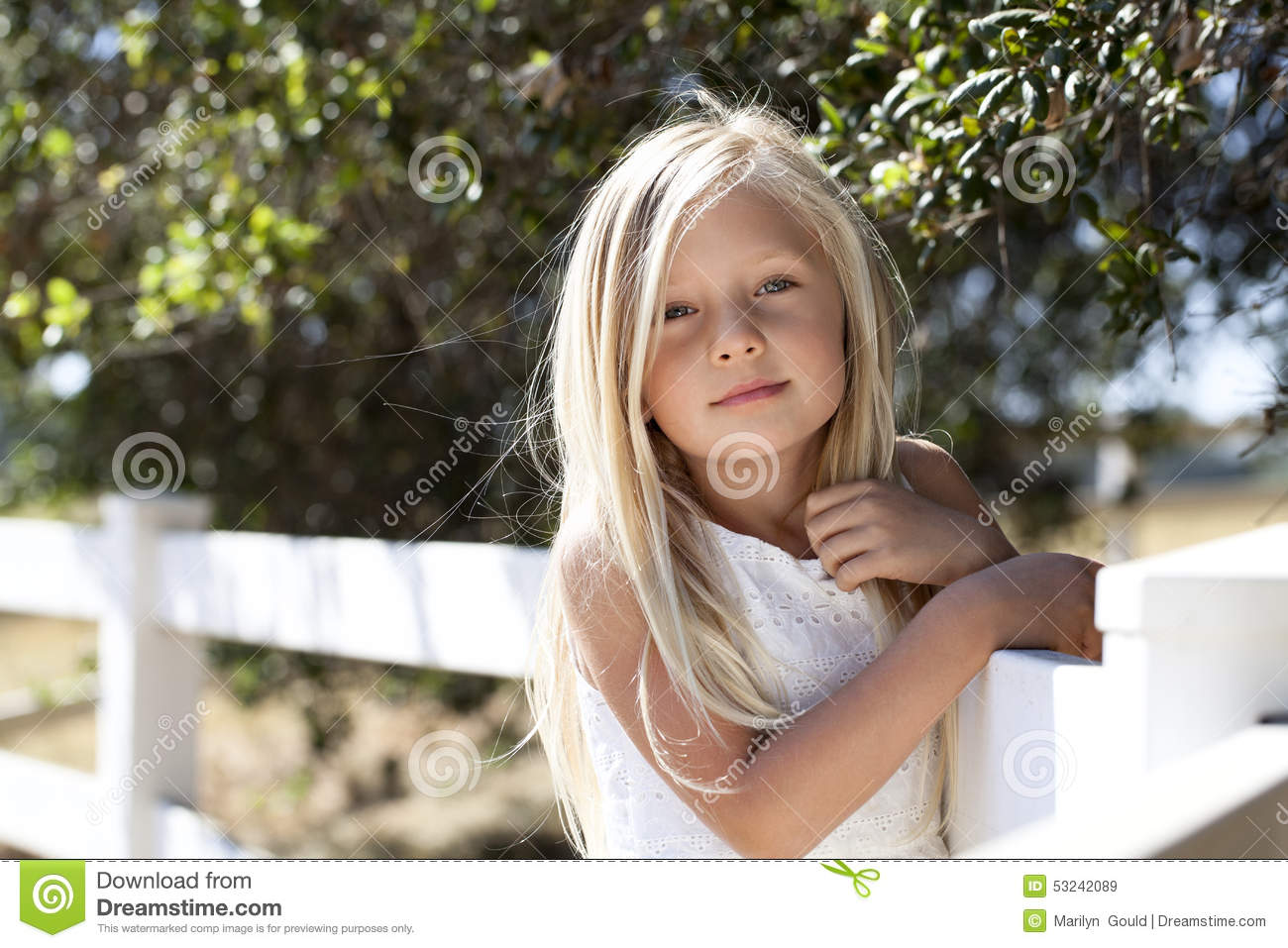 Young Blond Girl on Fence